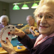 Senior adults playing bridge — Stock Photo