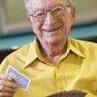 Senior man playing bridge — Stock Photo