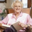 Stock Photo: Senior woman reading book