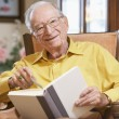 Stock Photo: Senior man reading book
