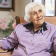 Senior woman relaxing in chair — Stock Photo #4790444
