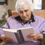 Senior woman reading book — Stock Photo #4790445