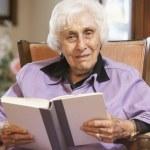Senior woman reading book — Stock Photo #4790446