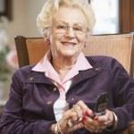 Senior woman text messaging — Stock Photo #4790466
