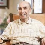 Senior man resting in armchair — Stock Photo