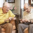 Stock Photo: Senior men text messaging