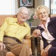 Senior couple holding hands — Stock Photo