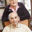 Senior couple relaxing in armSenior couple relaxing in armchairs — Stock Photo #4790495