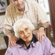 Senior couple relaxing in armchairs — Stock Photo #4790496
