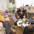 Senior adults having morning tea together — Stock Photo #4790499