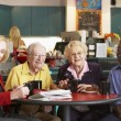 Senior adults having morning tea together — Stock Photo