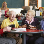 Senior adults having morning tea together — Stock Photo