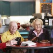 Senior adults having morning tea together — 图库照片