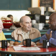 Stock Photo: Senior men drinking tetogether