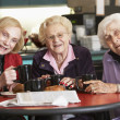 Senior women drinking tea together — Stockfoto