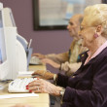 Senior woman using computer — Stock Photo #4790529
