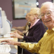 Senior man using computer - Stock Photo