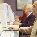 Senior man using computer — Stock Photo #4790531