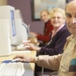 Senior man using computer — Stock Photo #4790532