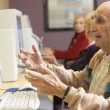 Stock Photo: Senior musing computer
