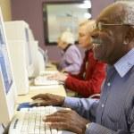 Senior man using computer — Stock Photo #4790544