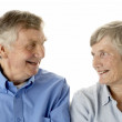 Portrait of senior couple smiling at each other — Stock Photo #4790652