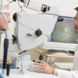 Doctor Checking Patient's Eyes - Stock Photo
