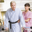 Stock Photo: Nurse With Patient In Rehabilitation