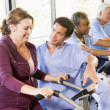 Stock Photo: Nurse With Patient In Rehabilitation Using Exercise Machine