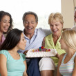 Stock Photo: Two Families Celebrating Birthday Together