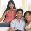 Stock Photo: Family Sitting Together At Home