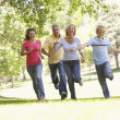 Family Running Through A Park — Stock Photo