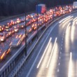 Blurred Tail Lights And Traffic Lights On Motorway — Stock Photo #4794462
