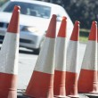 Traffic Cones Lined Up On The Side Of The Road - Photo