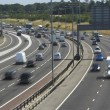 Blurred Traffic On A Busy Highway — Stock Photo