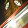 Double Decker Bus Speeding Past Big Ben, London, England - Stock Photo