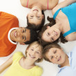 Overhead View Of Five Young Children In Studio — Stock Photo
