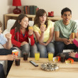 Stock Photo: Group Of Children Eating Burgers At Home