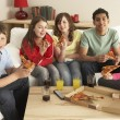 Group Of Children Eating Pizza At Home - Foto Stock