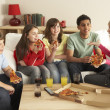 Group Of Children Eating Pizza At Home — ストック写真