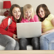 Group Of Three Girls Using Laptop At Home — Stock Photo #4794793