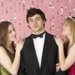 Two Teenage Girls Looking At Boy — Stock Photo