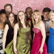 Group Of Teenage Friends Dressed For Prom - Stock Photo