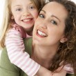 Portrait Of Cuddling Mother And Child — Stock Photo #4795385
