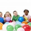 Group Of Young Children In Studio With Balloons — Stock Photo #4795466