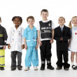 Stockfoto: Young Children Dressing Up As Professions