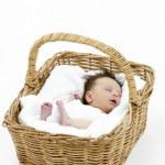 Newborn Baby Sleeping In Basket — Stock Photo