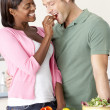 Young Couple Preparing Meal In Kitchen — Stock Photo #4795792