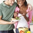 Young Couple Eating Meal In Kitchen — Stock Photo #4795815