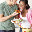 Young Couple Eating Meal In Kitchen — Stock Photo #4795819